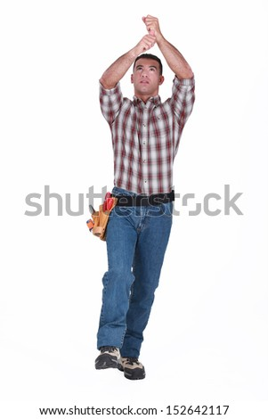 craftsman pulling an invisible rope - stock photo