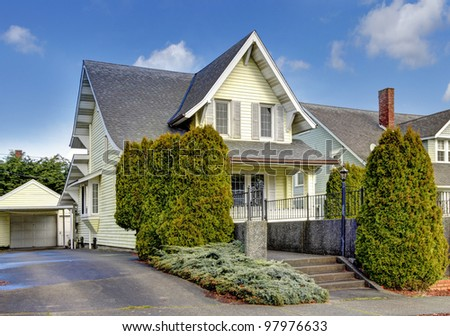 Craftsman style yellow cute American house exterior. - stock photo