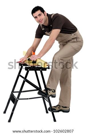 craftsman taking measurements - stock photo