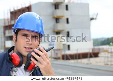 craftsman talking on a talkie walkie - stock photo
