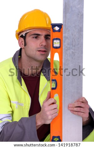 craftsman using ruler - stock photo