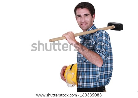 Craftsman with a sledgehammer. - stock photo