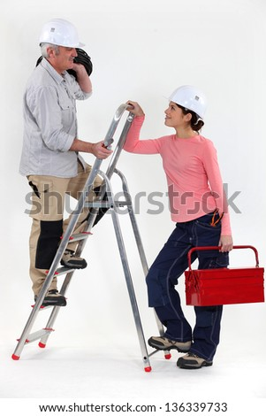 Craftsman working with his apprentice - stock photo