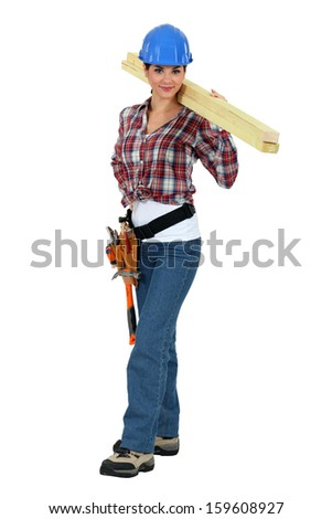Craftswoman holding a board - stock photo