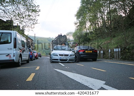 CRAGG VALE, UK - MAY 15, 2016: Early morning car crash on the Blackstone Road Edge Road running through Cragg Vale and close to the Cragg Vale Infant and Junior School. - stock photo