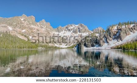 Cramer Lake reflection, Sawtooth National Recreation Area, near Stanley, ID - stock photo