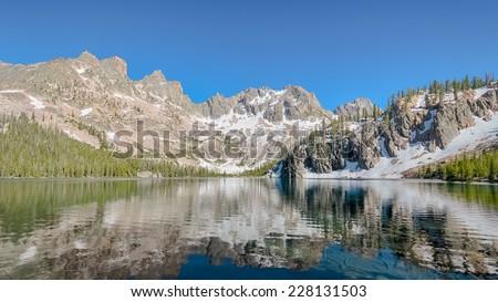 Cramer Lake reflection, Sawtooth National Recreation Area, near Stanley, ID - stock photo