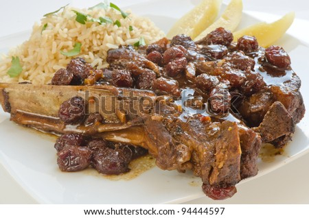Cranberries and ginger sweet-sour pork ribs - stock photo