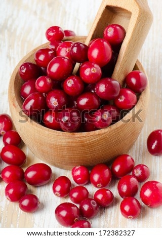 Cranberries on a  wooden table. Selective focus - stock photo