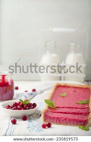Cranberry, bilberry custard tart, pie,cake with fresh berries and mint leaves on a white wooden background - stock photo