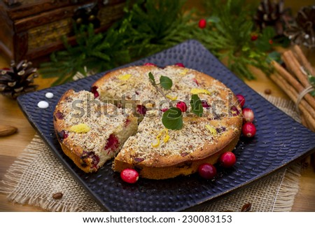 Cranberry cake with Xmas decorations - stock photo
