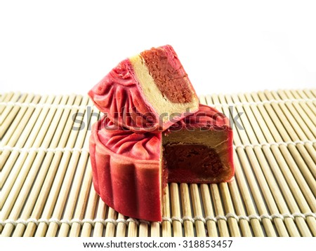 Cranberry & Earl Grey Moon cake on the white background, Red Moon cake, Autumn Moon cake festival food - stock photo
