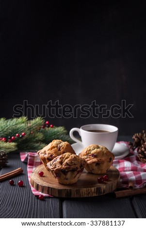 Cranberry muffin with cup of coffee on black background - stock photo