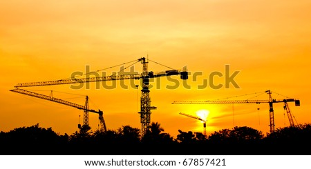 Crane and beautiful sunset - stock photo