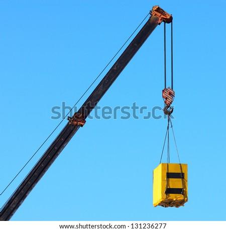 Crane and cargo. Element of building design. - stock photo