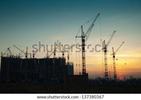 Crane at a construction site a new home - stock photo