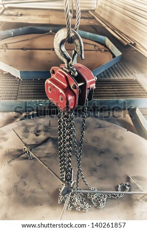 Crane chain and hook at the factory. - stock photo