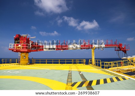 Crane construction on Oil and Rig platform for support heavy cargo, Transfer cargo or basket on work site, Heavy industry. - stock photo