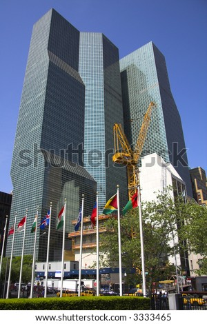 Crane in front of tall buildings in New York city - stock photo