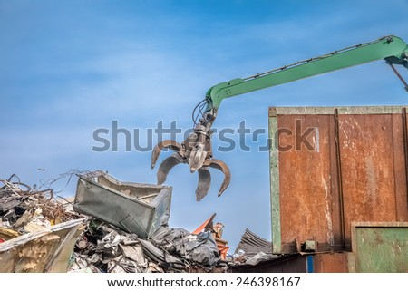 Crane in the junkyard - stock photo