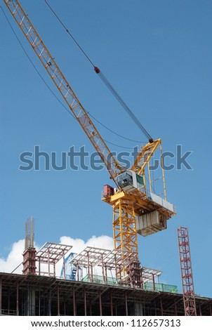 Crane is working on building under construction. - stock photo