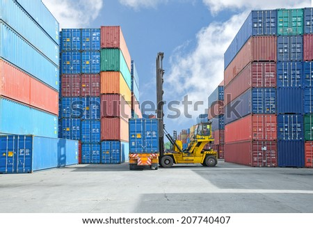 Crane lifter handling container box loading to truck - stock photo