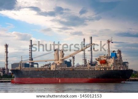 crane on Boat at Oil refinery factory in Thailand. - stock photo