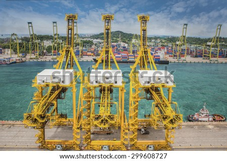 Crane operation, Landscape from bird view of Cargo ships entering one of the busiest ports in the world, Singapore - stock photo
