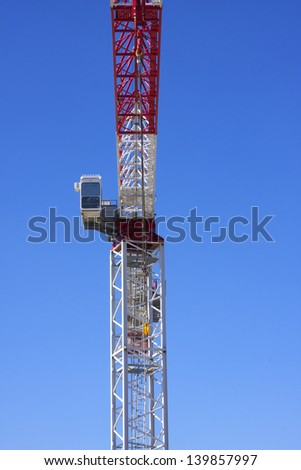 Crane operators cabin against a clear blue sky - stock photo