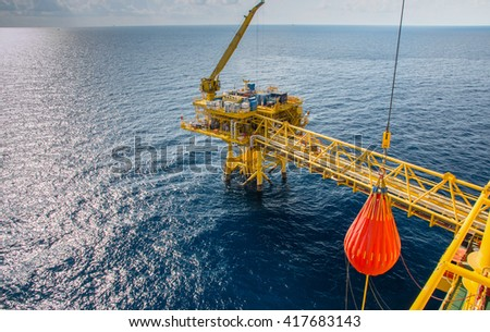 Crane, Pedestal crane winch,Pedestal crane pull load tested 100% by water bag, Steel wire rope on production platform, Energy and petroleum industry - stock photo