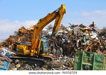 Crane picking up garbage - stock photo