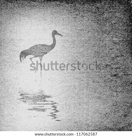 crane silhouette on old paper - stock photo
