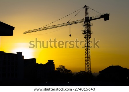 crane silhouette twilight - stock photo