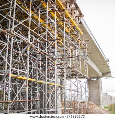 Crane site construction for building bridge - stock photo