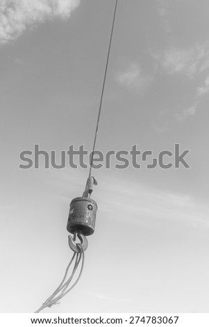 Crane sling under the blue sky and white clouds, at a construction site, china - stock photo