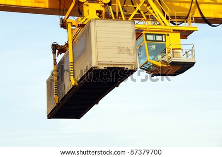Crane transporting container - stock photo