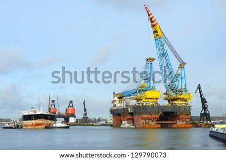 crane vessel and oil tanker - stock photo