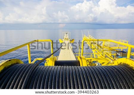 Crane winch, Steel wire rope drum on crane offshore wellhead platform, Energy and petroleum industry - stock photo