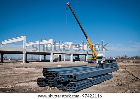 Crane works on construction - stock photo