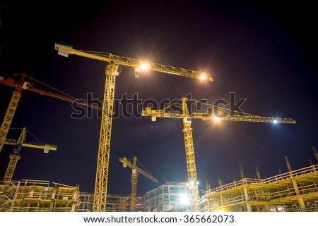 cranes and illumination at night - stock photo