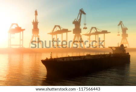 Cranes at a port in the evening - stock photo
