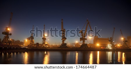 cranes in Casablanca harbor at night, Morocco - stock photo