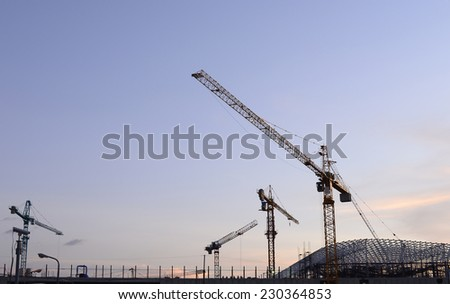 Cranes in the construction of large buildings. - stock photo