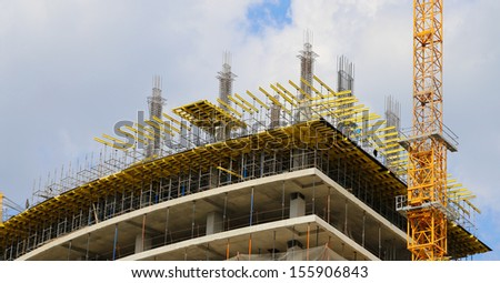Cranes on a construction site. Industrial image - stock photo