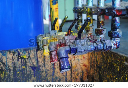 Cranes with CMYK paints at typography. - stock photo