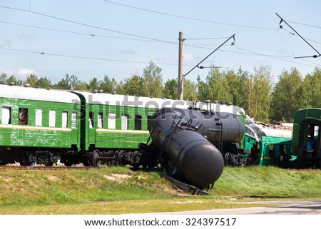 Crash of trains: the passenger train collided with the freight train - stock photo