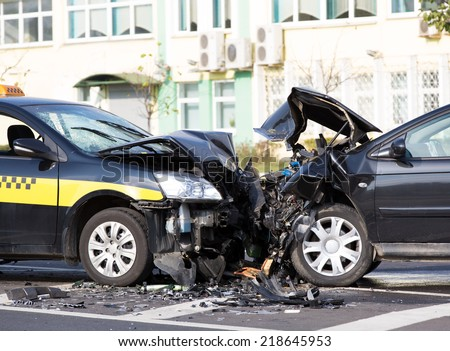 crashed cars automobile collision accident at city road - stock photo
