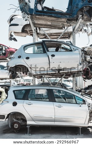 Crashed cars in dismantling yard. - stock photo