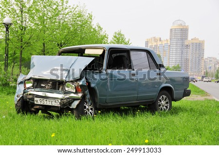 Crashed Lada 2107 on the roadside. Russia, Saint-Petersburg, Planernaya str. 18-05-2010 - stock photo