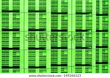 Crates for apples made of green plastic stacked up in storage - stock photo